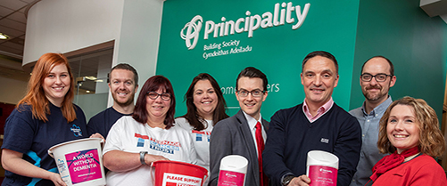 Image to show Principality's charity partners Alzheimers Society and Teenage Cancer Trust Cymru holding collection buckets with Principality Building Society colleagues