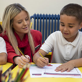Image showing a Principality colleague teaching a student about financial education.