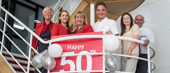 Bridgend colleagues pose with Chief Executive for branch 50th birthday