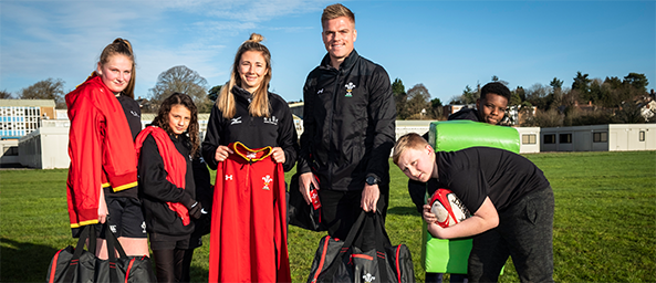Wales rugby star hand delivers kit donation to local charity