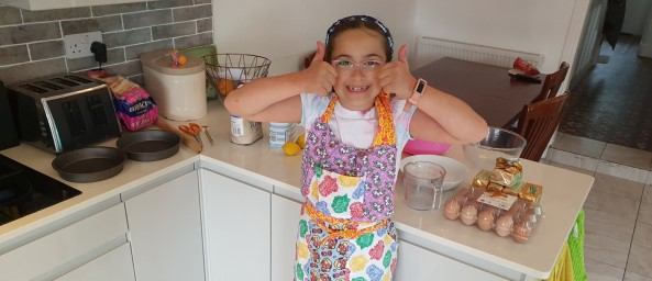 Indi baking and giving you the thumbs up