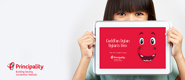 Image of a girl holding a tablet that reads 'Dylan's Den App'