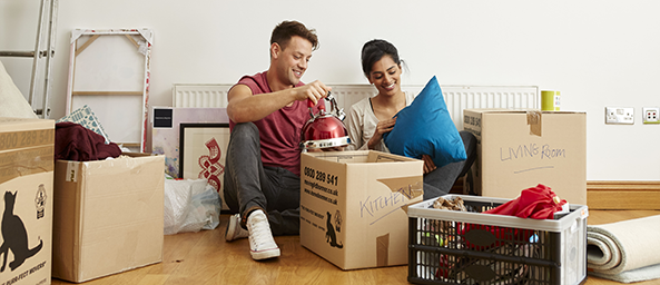 Couple surrounded with moving boxes