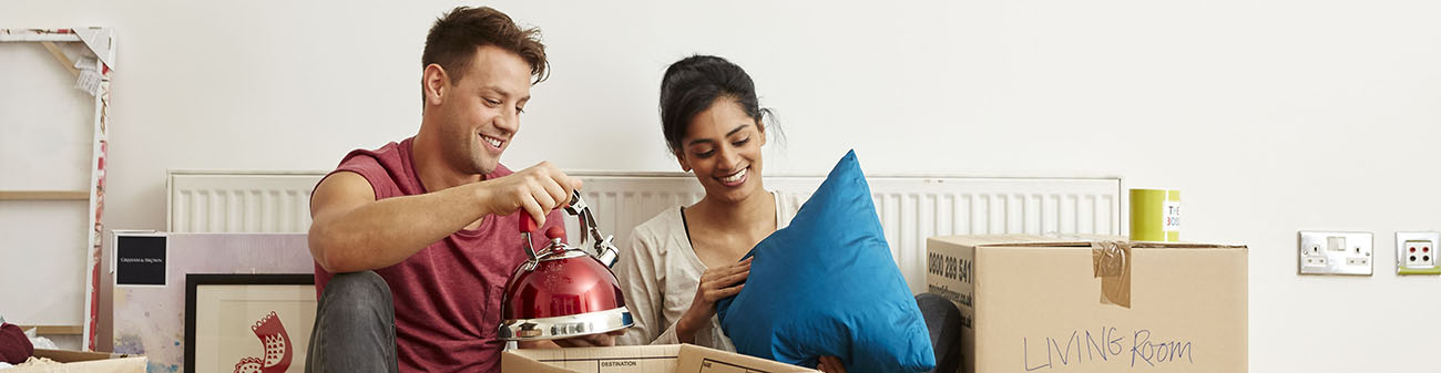 First time buyers - Couple unpack at new home